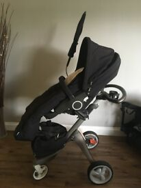 Stokke Xplory pushchair with accessories