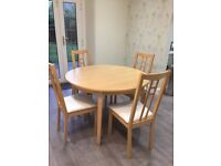 IKEA extendable round dining table with 4 chairs