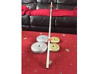 Barbell with 4 weight plates