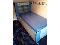 Blue single bed with storage