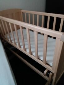 baby swinging crib for sale perfect condition not a mark on it