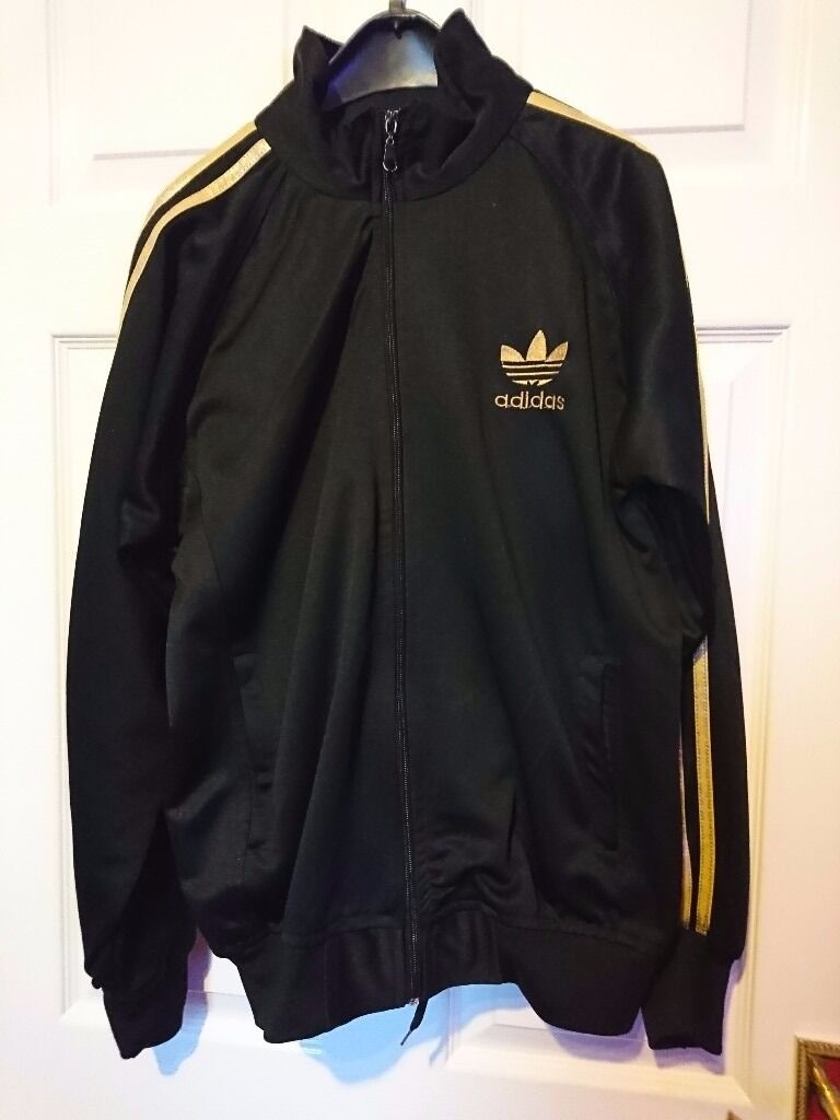 Womens black Adidas retro tacksuitin Gateshead, Tyne and WearGumtree - Womens black Adidas retro tracksuit. Adidas strips in gold with Adidas logo on chest, trousers with drawstring waist. Womens size 12 14