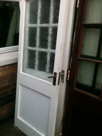 Exterior wooden door with large frosted glass panel