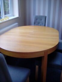 DINING TABLE, OAK COLOUR, LOOKS GREAT EXTENDABLE 45 inch diameter and 65.5 inch long