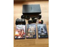 PlayStation 2 console with tomb raider games. ps2