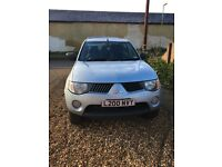 L200 with private plate