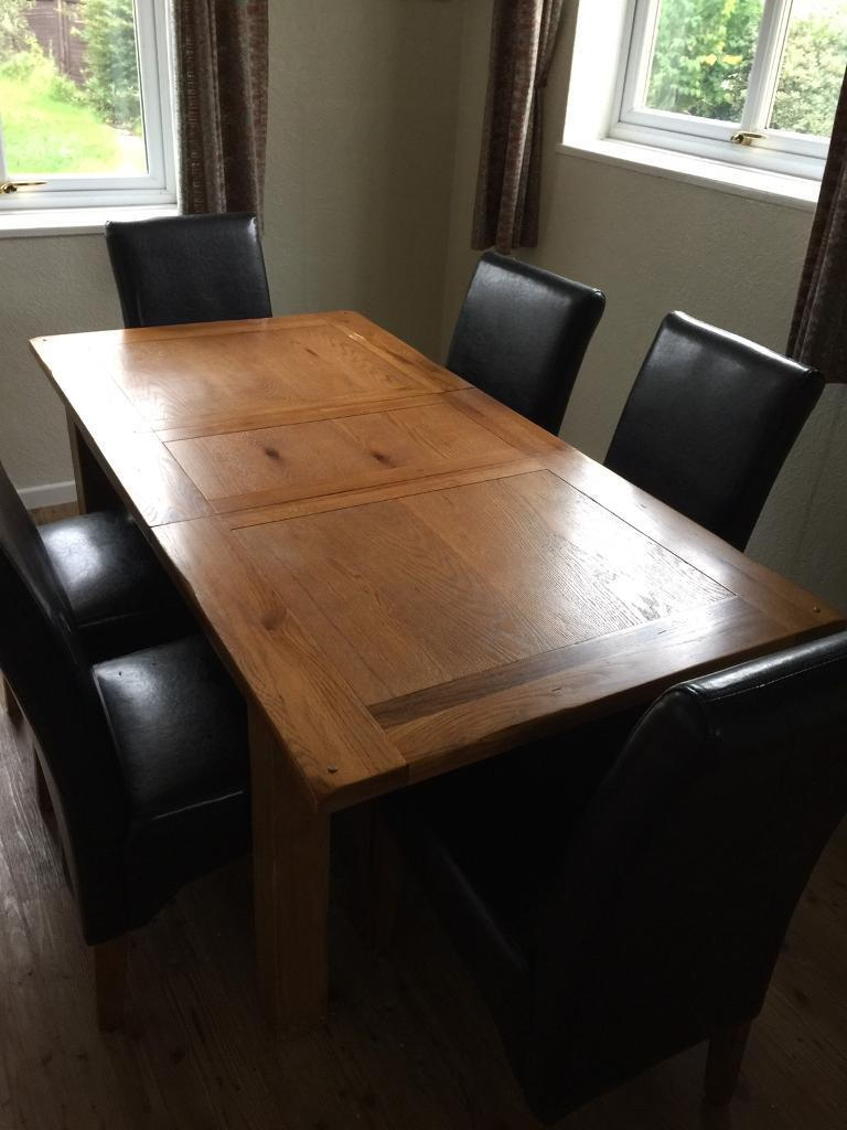Solid wood dinning table and six leather chairs