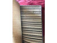Large black/grey/cream striped rug