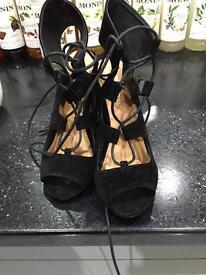 Black strap up shoes