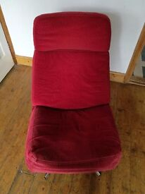 A RED SWIVEL ARMCHAIR