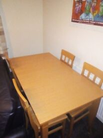 Pine dinner table and chairs. Needs gone tonight . Lower price