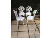 4 cast iron chairs