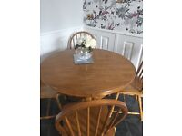 Good quality pine table & 4 chairs. £65.