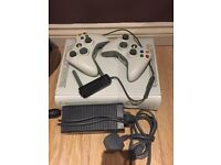 Xbox 360 with 2 controllers and a wireless network adapter