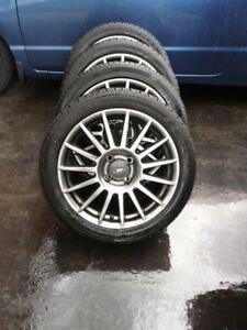 FORD FOCUS 2011 17 INCH FACTORY WHEELS WITH LIKE NEW HIGH PERFORMANCE 215/45/17 TIRES.