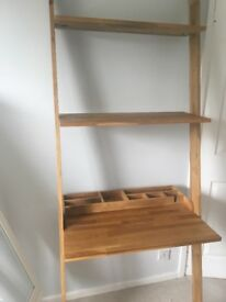 Lean to wooden desk with shelving