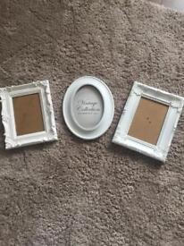 3 white vintage photo frames