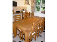 Solid oak stunning table and 8 chairs