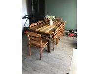 Large solid wooden table & 8 chairs
