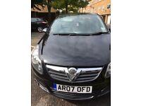 Black Vauxhall corsa
