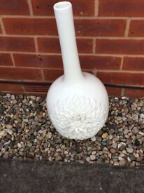 tall ceramic vase with large flower detail