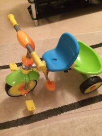 Multicolour childs tricycle with detachable handle/stick for adult to steer