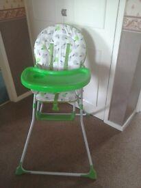 High chair. Green apple design.