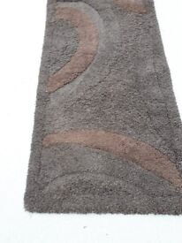 brown rug size is 5 ft x 2 ft 7 ins