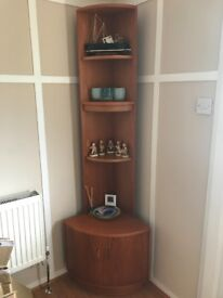 G-Plan style corner unit with low cupboard and three shelves.