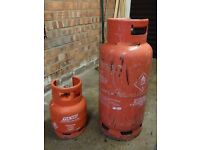 Two empty Flow Gas Propane gas bottles for sale..