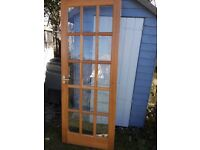 Two internal heavy wooden glazed doors. 15 pane bevelled glass with fittings. Great quality.