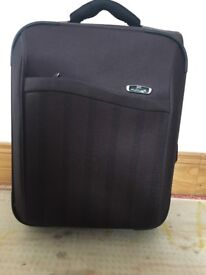 Small brown extendable suitcase