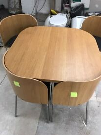 table chairs. compact 4 seater table chairs