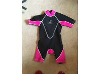 Pink shorty wetsuit suitable for age 9-11 year old