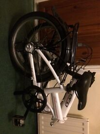 White folding Carrara bike.