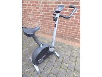 Static cycle fitness trainer with variable resistance