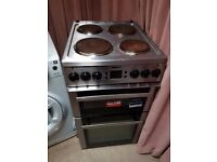 BEKO freestanding electric 4-hob cooker with grill.