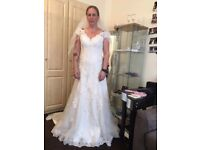 Lillian west wedding dress only tried on , size 14 but comes up small fits me and I'm a 10