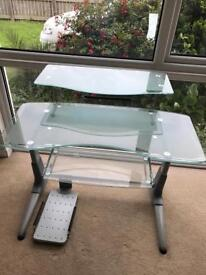 Glass Desk with sliding tray.