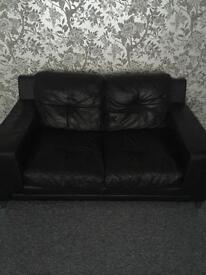 Black leather Sofa, Good Condition location Thornton Ono