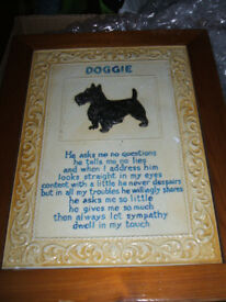 a doggie framed ceramic plaque