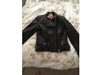 Genuine black leather jacket with labels still in