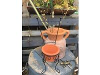 Terracotta plant pot in a quirky chair