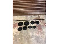 Weight training cast iron weights with barbell