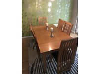Solid Oak Dining table and 8 chairs. Requires new seat pads.