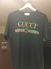 New black Gucci T-shirt worm once