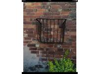 Old iron wall basket
