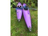 2 kayaks with spray decks and paddles