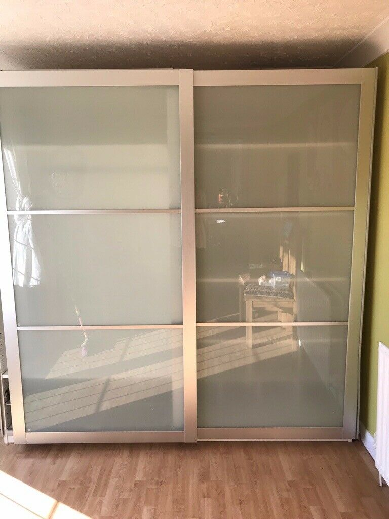 premium selection 89809 3837c Contemporary IKEA Pax wardrobe with sliding frosted glass doors, white  units and interiors white | in Brighton, East Sussex | Gumtree