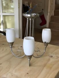 chrome and white ceiling light with three pendants in white glass